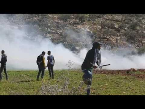 Clashes between Israeli forces and Palestinian protesters during demonstration in West Bank