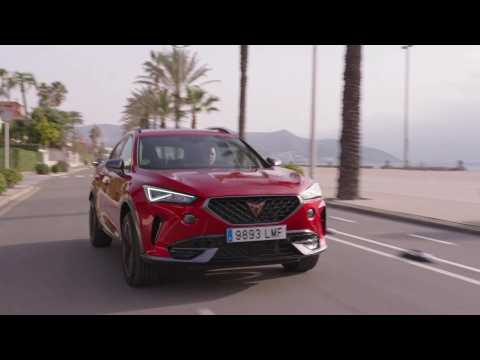 CUPRA Formentor 150 CV in Desire Red Driving in the city