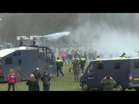 Clashes as police break up anti-government protest on eve of Dutch elections