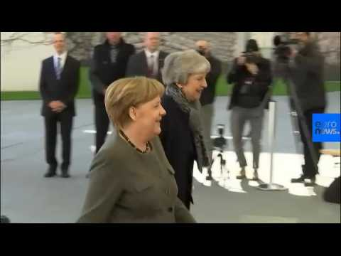 May and Merkel meet as UK parliament passes Brexit delay law