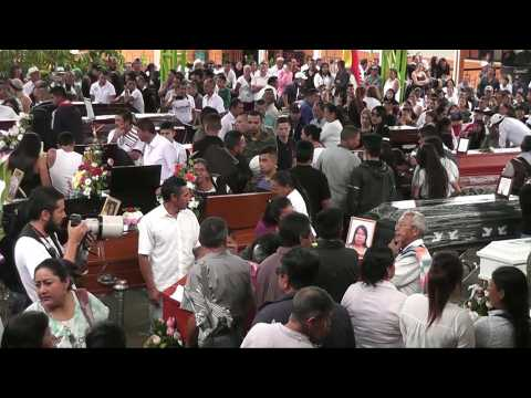 Colombians hold mass funeral for people killed in a landslide