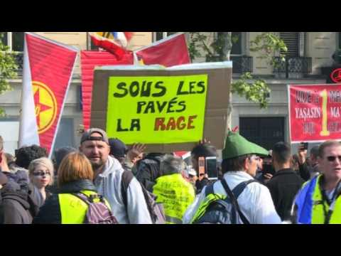 Protesters start gathering for May Day rally in Montparnasse