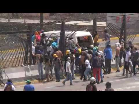 Protesters in Venezuela set van on fire on military air base