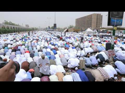 Sudanese protesters participate in Friday prayer in front of army HQ