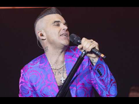 Robbie Williams rejected Queen's offer to fill Freddie Mercury's shoes