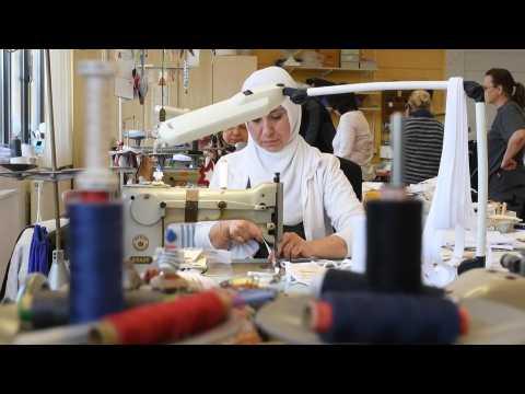 Germany: Non-medical staff sew masks in hospital as coronavirus cases soar