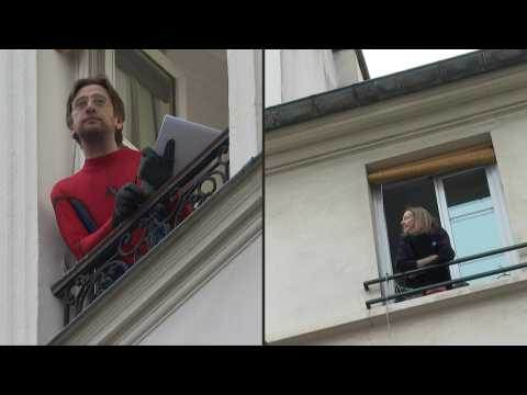 Parisians take to their balconies for quizzes to pass the time under confinement
