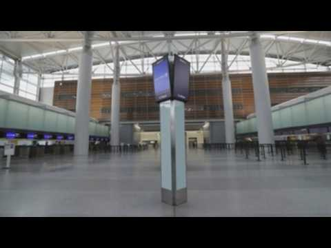 San Francisco airport nearly empty as airlines reduce flights due to COVID-19 pandemic