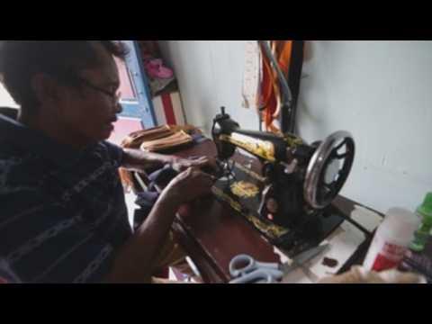 Indonesian tailors produce cloth face masks against COVID-19