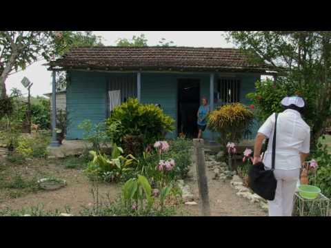 Cuban medics go door to door to track virus