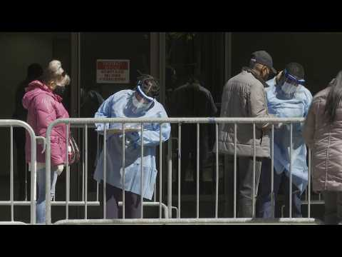 People wait outside newly opened COVID-19 testing center in Manhattan