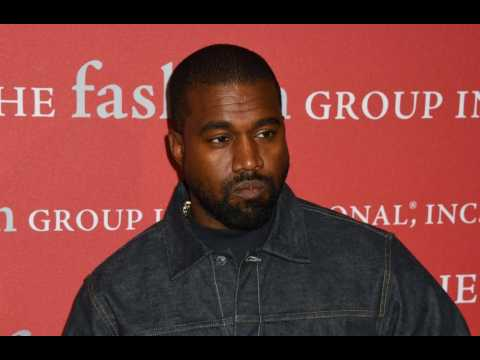 Kanye West performing at televangelist Easter service