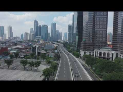 Empty streets in Jakarta to curb coronavirus pandemic