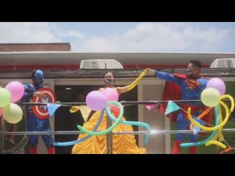 Colombian cops dress up as superheroes to celebrate Children's Day