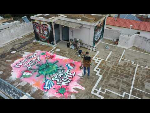 Teen graffiti artist paints COVID-19 mural on Athens roof