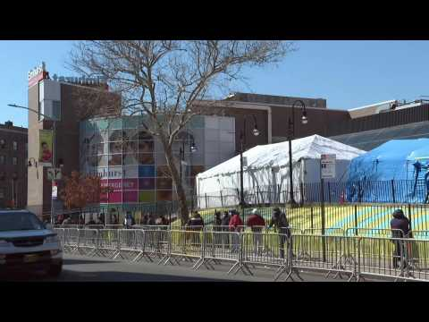 Coronavirus: people form long line for testing at NYC hospital
