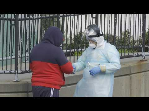 Coronavirus: People line up outside New York hospital to get tested