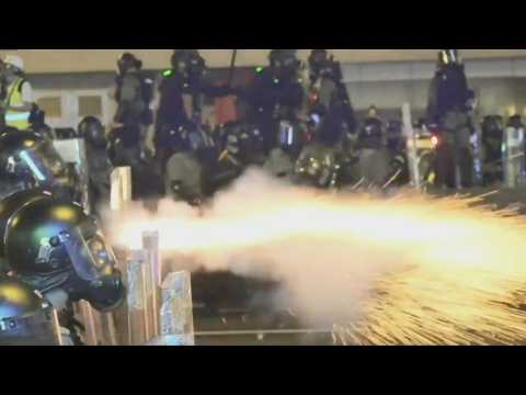 Tear gas: Hong Kong police and protesters clash