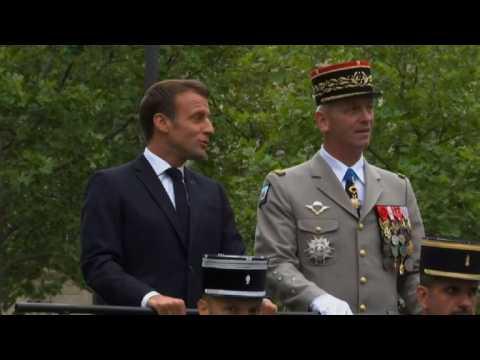 Macron arrives for Bastille Day parade