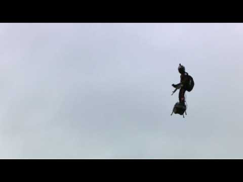 """A """"flying man"""" over the Champs-Elysees at Paris parade"""