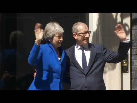 Outgoing Theresa May waves goodbye as she leaves Downing Street