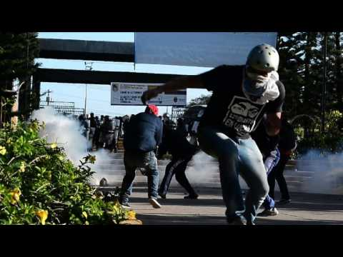 Honduran military police and protesters clash during demonstrations