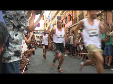 Men race in high heels for Madrid's Gay Pride festival