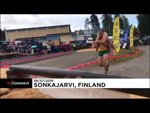 Couples from over a dozen countries compete in wife-carrying championships
