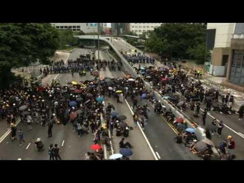 Protesters block major highway in Hong Kong