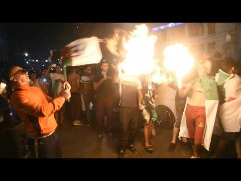 Algerians celebrate team's win at the Algiers' Post Office