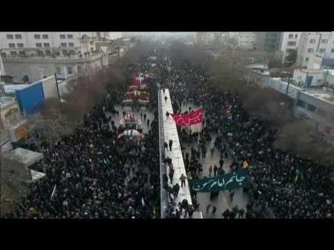 Iran: Mourners gather in Mashhad as top general's remains return