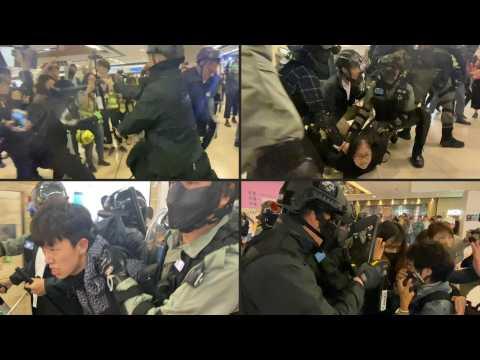 Calm broken as clashes break out in Hong Kong malls