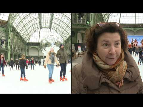 Parisians and tourists slide into 2020 on Paris's Grand Palais ice rink