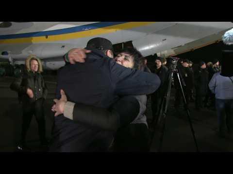 Ukrainian President Volodymyr Zelensky greets former prisoners at Kiev airport