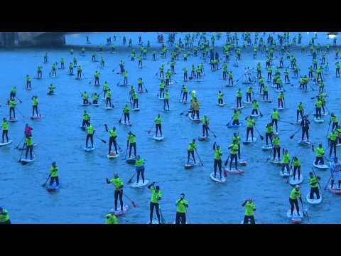 Paddle boarders invade the Seine in Paris