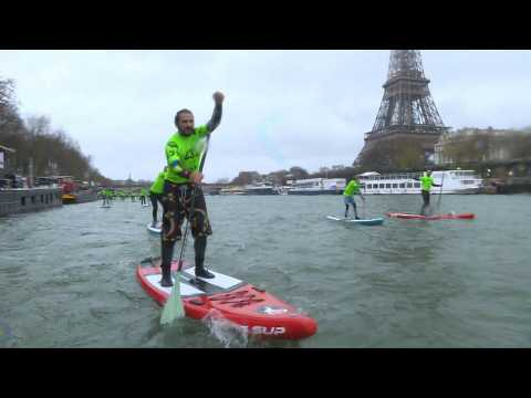 Hundreds of paddle boarders take part in Paris race