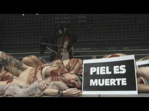 Activists emulate skinned animals in Madrid in protest against fur industry