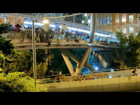 Dozens of Hong Kong protesters escape police siege at campus