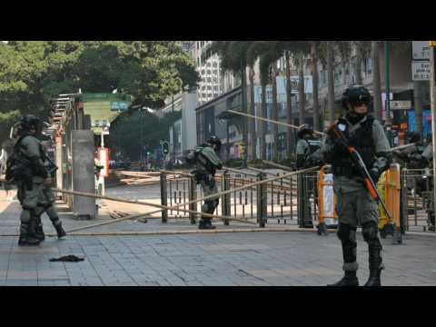 HK police clear barricades near campus protest siege