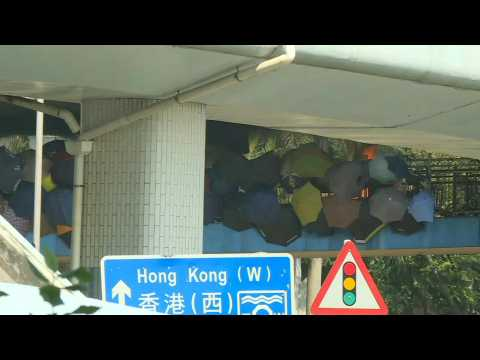 HK police on standby at campus day after intense clashes