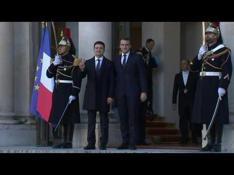 Merkel and Zelensky arrive at Elysee Palace for landmark Paris summit on Ukraine