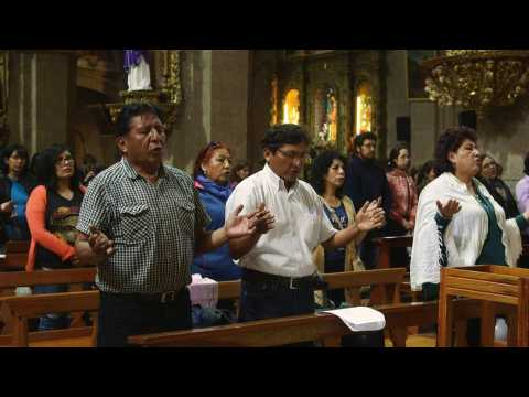 Bolivians hold mass for peace