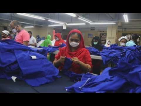 Bangladeshi workers wear masks to protect themselves from coronavirus