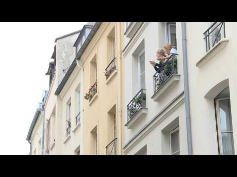 Parisians applaud healthcare workers from their windows
