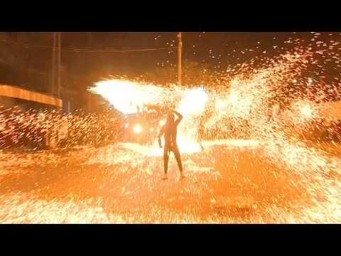 Palestinian youth swirl homemade sparkler firework for Ramadan