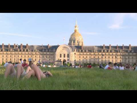 Parisians enjoy the sun in front of the Invalides
