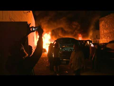 Cars set ablaze in Minneapolis as protesters ignore curfew orders