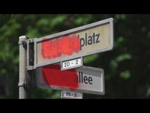 Anti-racism protesters cross out the names of some streets in Berlin