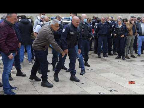 Angry French police throw handcuffs away in protest at claims of racism