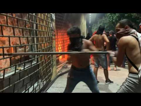 Angry Lebanese protesters set fire to shops in Beirut